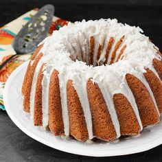 Pina Colada Bundt Cake with Pineapple glaze and flaked Coconut on top | Magnolia Days