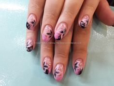 Pink and black gel polish with one stroke flower nail art Taken at:4/22/2014 12:36:40 PM Uploaded at:4/24/2014 6:13:33 PM Technician:Elaine Moore