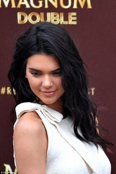 Doing her thing: Kendall expertly posed for the photocall, drawing on her wealth of modelling experience