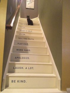 Words on stairs... interesting idea since you do look at them as you go up & down. I think I'd rather have them on the treads though - more subtle.