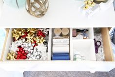 Home Organization- How to Create an Organized Gift Wrap Station, wrapping paper, wrapping station, holidays, Christmas presents, holiday gifts, bows, ribbon, gift bags, party supplies, wrapping paper storage, dresser for storing gift wrap supplies, organized ribbon and bows and gift tags