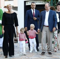 Prince Albert II of Monaco and his wife Princess Charlene arrive with their twins Prince Jacques (C-R) and Princess Gabriella (C-L) to take part in the traditional Monaco's picnic in Monaco, on September 1, 2017.