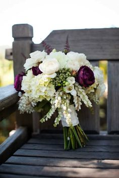 Like this but with more red. white peonys and roses with some freesia and rannuculus for bride bouquet