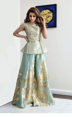 wide legged tissue palazzo pants paired with golden tissue peplum top Fashion Pakistan Pakistani Fashion Party Wear, Indian Fashion Dresses, Pakistani Dresses Casual, Pakistani Wedding Outfits, Indian Gowns Dresses, Dress Indian Style, Pakistani Dress Design, Indian Designer Outfits, Designer Clothing