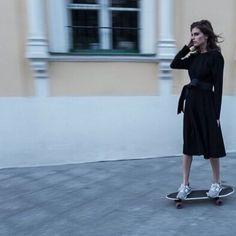 black shirt dress and skateboard