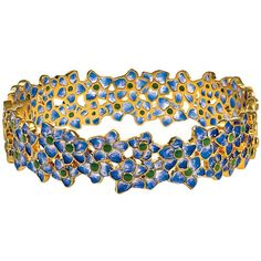 Enough showers, let's see some May flowers! This Tiffany Posy Bangle is based on an original design drawing (ca. 1905–10) by Tiffany Studios for a leaded-glass lampshade, featuring clusters of pretty blue flowers.