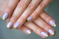 Use glitter gold nail polish to trick out your tips on a French mani.