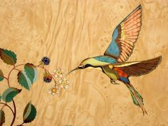 A stylised hummingbird in coloured and natural veneers.