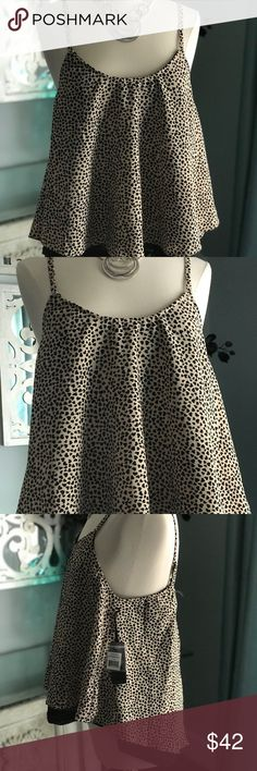 "Dex Clothing Baby Doll top Super cute Baby Doll top from Dex Clothing. Little black hearts make up this ""leopard"" print fabric. Underlayer is a black mesh. Scoop neck and split button back. Straps are adjustable. Polyester and the mesh is polyester/spandex. Dex Clothing Tops"