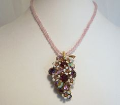Mid Century Weiss purple rhinestone pendant necklace with enamel metal flowers •Dark and light shades of purple, and aurora borealis lavender rhinestones •Rose quartz bead ... #vogueteam