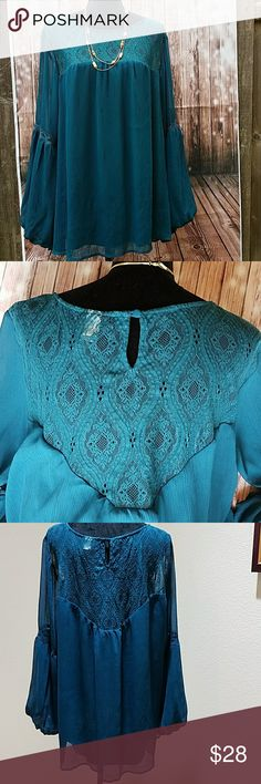 """Torrid Boho Top Green long sleeved top with lace detail across the  bust, back and sleeves. Blouse is lined. Sleeve is approximately 24"""" long with a strip of lace mid way. Elastic around wrist - see last picture. Total Length - 30"""", bust -27"""" flat. Cool flowy polyester top. EUC. Size 4. Torrid Tops Blouses"""