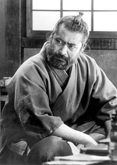 Mifune as Kikuchiyo in Akira Kurosawa's Seven Samurai Japanese actor Toshiro Mifune was born on April 1920 in Tsingtao (a. Toshiro Mifune, Samurai Art, Samurai Warrior, Japanese Film, Japanese Artists, Red Beard, Beard Man, Epic Beard, Tyler Durden