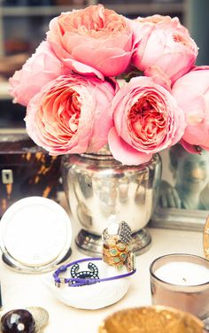 Roses in a silver vase/jar.  What a welcoming site for travel-weary guests.  Do you see the little ccs in the dish?  I can't tell if those are earrings or a pattern on the dish, but I like a little shout-out to Coco.