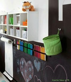 love this for a kids play room! Wall chalkboard!! - and roll of paper to clean up right there!