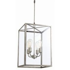 Savannah Pendant from Arteriors Home features aged iron rectangular frame. Large glass panels surround 4 arm lighting to create rich, yet understated style for dining room or entry way.