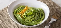 "The Green ""Tallarines"" are nothing more than spaghettis just a bit wider than the regular ones we find here, bathed in an exquisite green peruvian sauce."