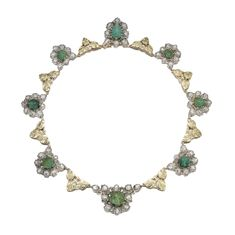 Emerald and diamond necklace, Buccellati, circa 1965 Composed of links of open work foliate design, set with carved emeralds and highlighted with rose diamonds, length approximately 400mm, signed Buccellati.