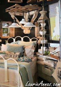 Retail display at LaurieAnna's, bed canopy created from a pallet. http://laurieannas.com
