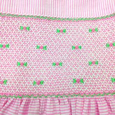 http://kasumisou.com/product.php?productid=80&cat=6&page=1 Hand smocked, hand embroidered, and expertly sewn by disadvantaged women at a self help center in Thailand. Princess Charming® pink striped seersucker dress details: Self piping around neck and armholes, white buttons down the bodice back, long wide ties for making a bow and adjusting size. Smocking is self lined. #smocked #smocking #design #sew #girls #clothing