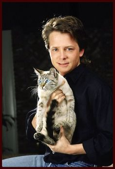 Michael J. Fox with his Lynx-point Siamese