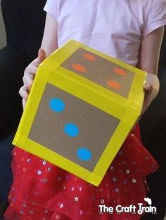 DIY giant cardboard dice! A fun way to work on numbers, counting or math!