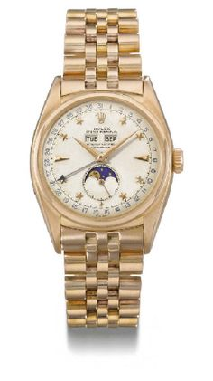 Rolex. A very fine and extremely rare 18K pink gold self-winding water-resistant triple calendar wristwatch with phases of the moon, bracelet and star dial.