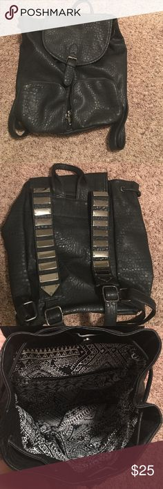 """Black leather back pack. Super fun back pack. I do not believe this is genuine leather, but it looks and feels as close as it gets! Beautiful soft black with black and white inside. Two outside pockets and three inside. 14"""" tall x 12"""" across the top and 7"""" deep. Perfect to be used as a purse or small carry on. Only used twice Bags Backpacks"""