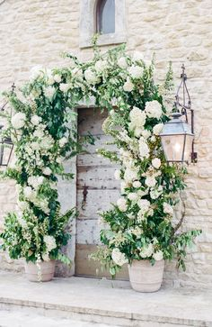 green-and-white floral arch