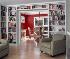contemporary living room by Bud Dietrich, AIA - beautiful how the bookshelves frame the dining room. The red walls enhance the look.