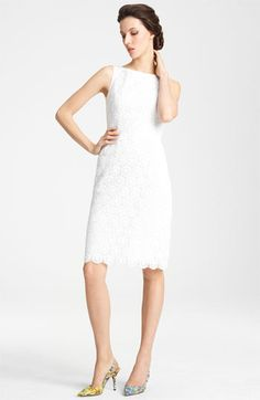 Classic! Again, this is what $2125 gets you... Dolce Boatneck Lace Dress