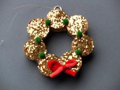 Gold glitter wreath from upcycled wine cork crafts for holiday decoration. $5.00, via Etsy.