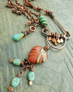 I made this funky little copper bail a while back, and stashed it away until I had an idea for it. I was looking at it the other day, and thought perhaps I would do something in a classic Southwest color scheme. I went through my stash of red jasper and found these carved leaves, some with lovely translucent veining, like the one above. I combined it with little turquoise ovals, chunky turquoise heishi, and delicate red jasper rondelles. I added some copper paddles to the bar, a straight…