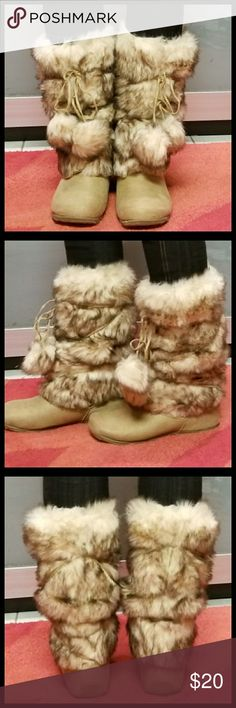 "Faux fur boot Pre-owned,  maybe worn couple.  Light furry boot,  manmade material Approx shaft height 11"" Approx cir 13"" Please see pictures for flaw de blossom Shoes Winter & Rain Boots"