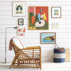 Not just for grandma's any more, cane and wicker furniture are making a comeback! Cool for summer, these lightweight materials are being used in sleek angular styles, perfect for the modern home. Pic: Serena & Lily. #interior #design #gallerywall #artwall #wicker #cane #furniture
