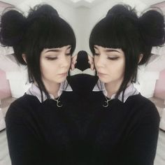 I love the black hair and the style of her bangs!!