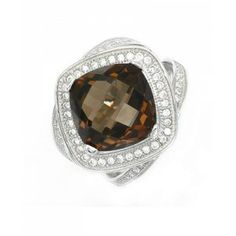 our 6.76 CTW Genuine Smoky Topaz White Gold plated Sterling Silver Ring is the perfect gift for someone you love.