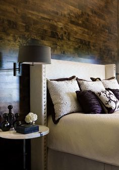 Atlanta Homes & Lifestyles - bedrooms - wood wall, wood plank wall, m wingback headboard, upholstered headboard, purple pillow, bedroom scon...