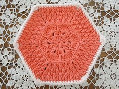 Start by making the African Flower hexagon . The tutorial here  explains how to crochet it really well! The only change you need to make is...