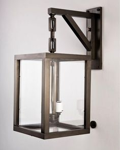 Fabulous outdoor lighting for the right home. LOVE this. Heron Exterior Wall Lantern