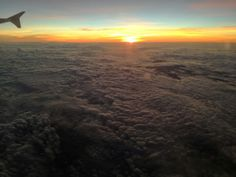 sunset above a sea of clouds, returning from nepal (: