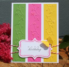 I have this embossing template! great use of the scrap papers, and i like the glitter on the tips of the flowers