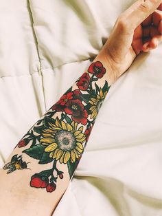 My floral tattoo half sleeve with sunflowers and a bee done by Sam at American Crow Tattoo in Gahanna, Ohio #tattoo #ink #floraltattoo #sunflower #floralsleeve #floral #tattoosleeve #flowers #inkedgirls #sunflowertattoo #girlswithtattoos