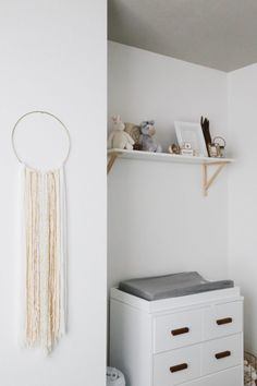 A super sweet little nook for a changing table. We love how tiny this table is - it's perfect for the space!
