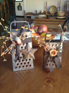 Primitive Crafts--Cheese graters, sprayed to look rusty, pips and an acorn/flower for a little pizazz