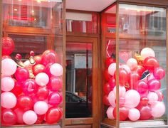 Valentines window display- balloons.  diy cute and cheerful window displays for retail.