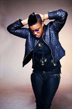 Toya looks awesome in her black bomber jacket crucifix knit and round sunglasses Black Bomber Jacket, Music Artists, Round Sunglasses, African, Crucifix, Gold Leather, Knitting, Jackets, Awesome