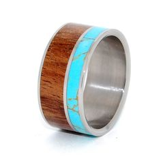 Majestic Earth. Asymmetrical inlays of Tibetan Turquoise and Koa Wood set in a mirror finish titanium ring. The delicate gold-lace webbing of this wondrous stone is complimented by the warm tones of n