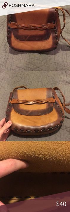 Leather hand made purse All real leather hand crafted purse! Beautiful and useful purse. Great condition some wear on the leather but was designed to look like that. The purse has never been used just in storage Bags