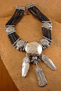 Black beaded necklace with three silver feathers by The Mummy's Bundle
