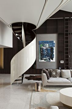 Refurbishment of a riverside penthouse apartment with views across London. The design creates an eclectic mix of spaces around the apartment with a rich variety of materials and a number of bespoke elements including a lightweight mezzanine with concealed hangers floating in a double-height space.